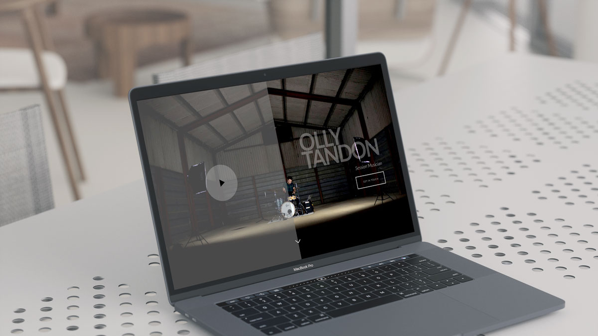 Olly Tandon Music website open on a MacBook Pro.